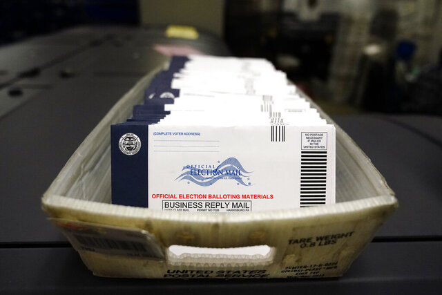 Mail-in ballots for the 2020 General Election in the United States are seen before being sorted at the Chester County Voter Services office, Friday, Oct. 23, 2020, in West Chester, Pa. (AP Photo/Matt Slocum)