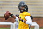 FILE - In this Aug. 12, 2019, file photo, Missouri quarterback Kelly Bryant throws during the NCAA college football team's practice in Columbia, Mo. Missouri plays at Wyoming this week. Bryant led Clemson to the 2017 national championship game before losing his job to Trevor Lawrence after four games last season. At Missouri, he'll be asked to replace Drew Lock, who accounted for 12,193 yards and 99 touchdowns over his career and led the Tigers to bowl games each of the past two years. (AP Photo/Jeff Roberson, File)