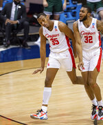Houston forward Fabian White Jr. (35) reacts after scoring during the first half of a first-round game against Cleveland State in the NCAA men's college basketball tournament, Friday, March 19, 2021, at Assembly Hall in Bloomington, Ind. (AP Photo/Doug McSchooler)