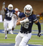 Utah State's Baron Gajkowski (15) returns a blocked punt 16 yards for a touchdown against UNLV during an NCAA college football game Saturday, Oct. 13, 2018, in Logan, Utah. (Eli Lucero/The Herald Journal via AP)