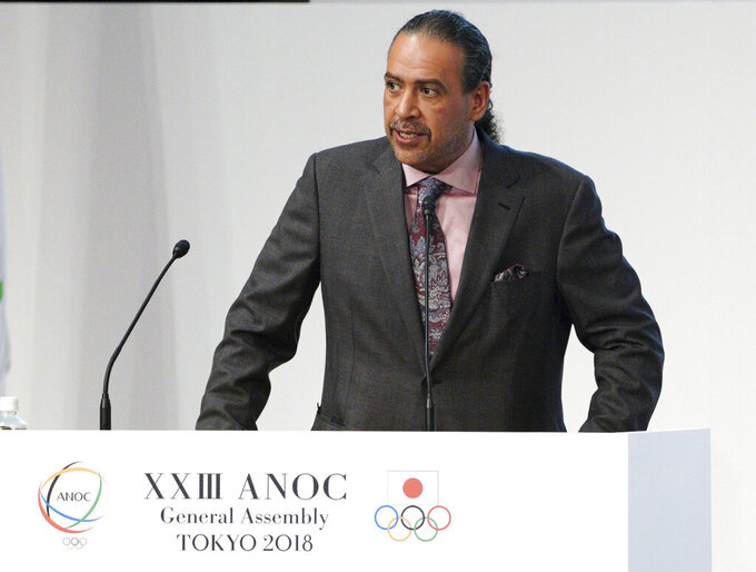 FILE - In this file photo dated Wednesday, Nov. 28, 2018, Sheikh Ahmad al Fahad al Sabah, president of the Association of National Olympic Committees (ANOC)  during the ANOC general assembly in Tokyo.  Sheikh Ahmad was indicted in an alleged forgery case with four others by prosecutors in Geneva and their delayed trial is due to begin in August 2021. (AP Photo/Eugene Hoshiko, FILE)