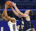 Utah State's Justin Bean, right, gets the upper hand on the ball from Air Force's Nikc Jackson during the first half of an NCAA college basketball game Thursday, Dec. 31, 2020, at Air Force Academy, Colo. (Jerilee Bennett/The Gazette via AP)