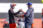 Cleveland Browns head coach Kevin Stefanski, left, and New York Giants head coach Joe Judge shake hands during a joint NFL football training camp practice Friday, Aug. 20, 2021, in Berea, Ohio. (AP Photo/Ron Schwane)