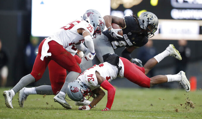 Colorado wide receiver Laviska Shenault Jr., back right, is tackled by Washington State safety Jalen Thompson, front, right, and safety Skyler Thomas after pulling in a pass in the second half of an NCAA college football game Saturday, Nov. 10, 2018, in Boulder, Colo. Washington State won 31-7. (AP Photo/David Zalubowski)