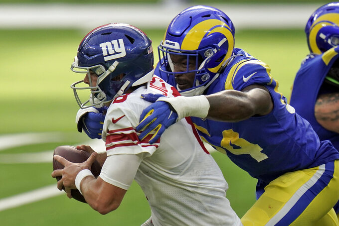 New York Giants quarterback Daniel Jones, left, is tackled by Los Angeles Rams outside linebacker Leonard Floyd during the second half of an NFL football game Sunday, Oct. 4, 2020, in Inglewood, Calif. (AP Photo/Jae C. Hong)