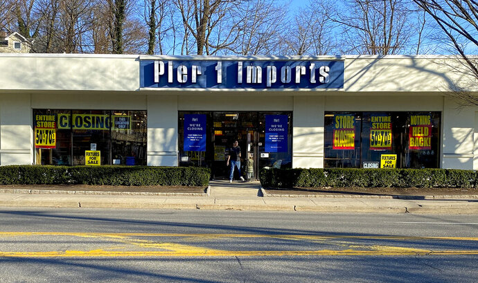 A customer steps out of a Pier 1 Imports store which was having a closeout sale, Monday, Feb. 17, 2020, in Larchmont, N.Y. Home goods retailer Pier 1 Imports Inc. filed for bankruptcy protection Monday after years of sliding sales. The Fort Worth, Texas-based company, which was founded in 1962, has recently struggled with increased competition from online retailers such as Wayfair. (AP Photo/Julie Jacobson)
