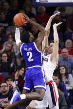 Texas-Arlington forward Jordan Phillips, left, shoots over Gonzaga forward Filip Petrusev during the second half of an NCAA college basketball game in Spokane, Wash., Tuesday, Nov. 19, 2019. Gonzaga won 72-66. (AP Photo/Young Kwak)