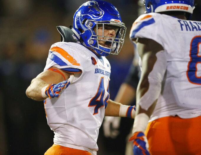 Boise State Broncos linebacker Riley Whimpey, left, celebrates his sack with linebacker Jabril Frazier in the second half of an NCAA college football game against Air Force, Saturday, Oct. 27, 2018, at Air Force Academy, Colo. (AP Photo/David Zalubowski)