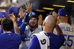 Los Angeles Dodgers' Max Muncy celebrates a two-run home run in the dugout during the second inning of a baseball game against the New York Mets on Sunday, Aug. 15, 2021, in New York. (AP Photo/Adam Hunger)