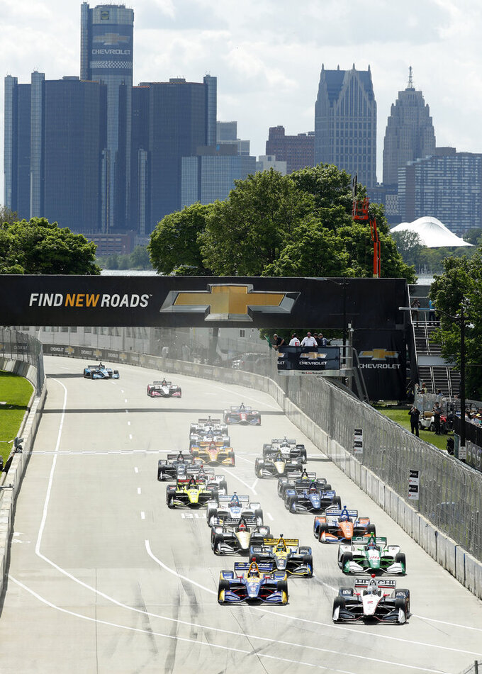 The field takes the green flag at the start line during the second race of the IndyCar Detroit Grand Prix auto racing doubleheader in Detroit, Sunday, June 2, 2019. (AP Photo/Paul Sancya)