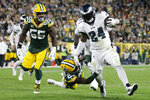 Philadelphia Eagles running back Jordan Howard breaks the tackle of Green Bay Packers cornerback Jaire Alexander during the first half of an NFL football game Thursday, Sept. 26, 2019, in Green Bay, Wis. (AP Photo/Jeffrey Phelps)