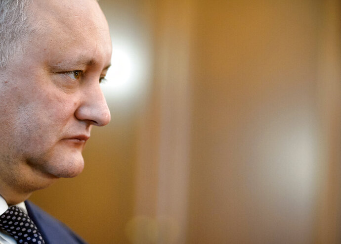 Moldova's President Igor Dodon listens to a question during an interview with the Associated Press in Chisinau, Moldova, Thursday, Feb. 21, 2019. Dodon says the former Soviet republic needs good relations with Russia, amid uncertainty about the future of the European Union. (AP Photo/Andreea Alexandru)