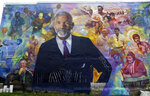 A mural of journalist Ed Bradley is seen, Wednesday, May 16, 2018 in Philadelphia. The mural, by artist Ernel Martinez, is in the Belmont neighborhood of west Philadelphia where Bradley grew up. A free public dedication of the mural is scheduled for Saturday May 19. (AP Photo/Jacqueline Larma)