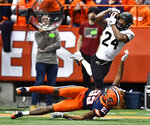 Wake Forest wide receiver Donavon Greene (24) makes a catch over Syracuse defensive back Ifeatu Melifonwu (23) during the second half of an NCAA college football game in Syracuse, N.Y., Saturday, Nov. 30, 2019. Syracuse beat Wake Forest 39-30 in overtime. (AP Photo/Adrian Kraus)