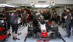 Haas driver Kevin Magnussen of Denmark sits in his car as it is tended to by pit crew during a free practice at the Barcelona Catalunya racetrack in Montmelo, just outside Barcelona, Spain, Friday, May 11, 2018. The Formula One race will take place on Sunday. (AP Photo/Manu Fernandez)