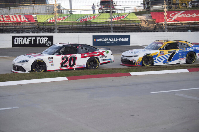 Harrison Burton (20)stays in front of Justin Allgaier (7) late in the race during a NASCAR Xfinity Series auto race at the Martinsville Speedway in Martinsville, Va., Saturday, Oct.31, 2020. (AP Photo/Lee Luther Jr.)