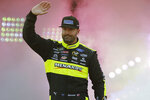 FILE - In this April 13, 2019, file photo, Paul Menard waves to fans during driver introductions prior to the start of the NASCAR Cup series auto race at Richmond Raceway in Richmond, Va. Menard has decided to walk away from NASCAR's top level after more than 460 races and Wood Brothers Racing is replacing him with Matt DiBenedetto in the iconic No. 21 Ford next season. After spending 16 years in the Cup Series, Menard said Tuesday, Sept. 10, 2019, he wants to step back from full-time racing to spend more time with his family. (AP Photo/Steve Helber, File)