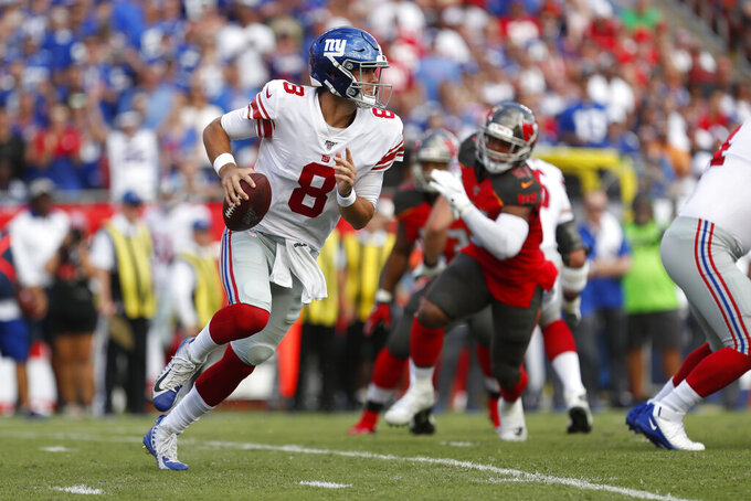 FILE - In this Sept. 22, 2019, file photo, New York Giants quarterback Daniel Jones (8) runs against the Tampa Bay Buccaneers during the first half of an NFL football game, in Tampa, Fla. Surviving in the NFL as a young quarterback means being able to move. That doesn't mean running as well as Lamar Jackson. Gardner Minshew, Kyle Allen and even Daniel Jones are showing that being able to elude pressure is a must to keep throwing the ball. (AP Photo/Mark LoMoglio, File)
