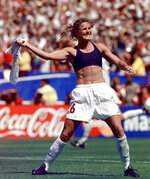 FILE - In this July 10, 1999, file photo, the United States' Brandi Chastain celebrates by taking off her jersey after kicking in the game-winning goal in a penalty shootout against China in the FIFA Women's World Cup Final at the Rose Bowl in Pasadena, Calif. Social media is finding little to like about the likeness on a plaque honoring the retired soccer champion. The Bay Area Sports Hall of Fame in San Francisco unveiled the plaque on Monday, May 21, 2018. Chastain diplomatically said