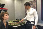 Indianapolis 500 champion Simon Pagenaud looks at the wreath he won less than a week ago and lamented seeing the leaves and orchids wilting, Friday, May 31, 2019 in Detroit. At the doubleheader in Detroit, the IndyCar points leaders is looking for a way to preserve his coveted prize and is energized to stay on top of the series. (AP Photo/Larry Lage)