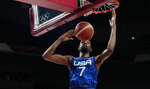 United States' Kevin Durant (7) scores during men's basketball quarterfinal game against Spain at the 2020 Summer Olympics, Tuesday, Aug. 3, 2021, in Saitama, Japan. (AP Photo/Eric Gay)