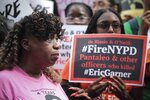 Gwen Carr, left, mother of chokehold victim Eric Garner, joins a