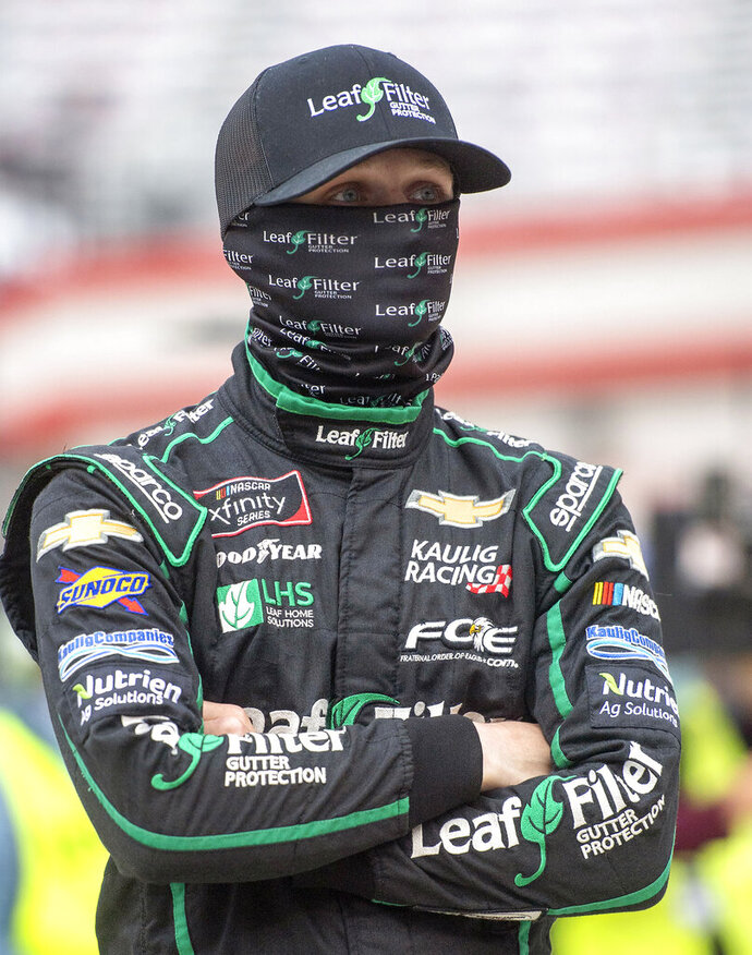 Justin Haley waits on pit road for the start of the NASCAR Xfinity Food City 300 Friday night at Bristol Motor Speedway. (David Crigger/Bristol Herald Courier via AP)