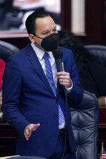 Florida Rep. Carlos Guillermo Smith speaks during a legislative session, Wednesday, April 28, 2021, at the Capitol in Tallahassee, Fla. (AP Photo/Wilfredo Lee)