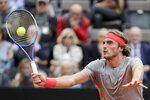 Stefanos Tsitsipas of Greece returns the ball to Rafael Nadal of Spain during a semifinal match at the Italian Open tennis tournament, in Rome, Saturday, May 18, 2019. (AP Photo/Andrew Medichini)
