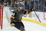 Vegas Golden Knights center Chandler Stephenson (20) celebrates after scoring against the St. Louis Blues during overtime of an NHL hockey game Saturday, Jan. 4, 2020, in Las Vegas. (AP Photo/John Locher)