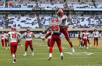 North Carolina State's Reggie Gallaspy II (25) and Kelvin Harmon (3) celebrate following Gallaspy's touchdown against North Carolina in the second half of an NCAA college football game in Chapel Hill, N.C., Saturday, Nov. 24, 2018. North Carolina State won 43-28 in overtime. (AP Photo/Gerry Broome)