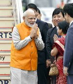 Indian Prime Minister Narendra Modi is greeted on his arrival at Kansai International Airport in Izumisano, Osaka prefecture, Thursday, June 27, 2019. Group of 20 leaders gather in Osaka on June 28 and 29 for their annual summit.(Nobuki Ito/Kyodo News via AP)