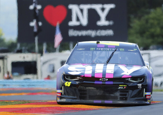 FILE - In this Aug. 3, 2019, file photo, Jimmie Johnson (48) drives through the area of the course called