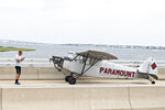 Landon Lucas, 18, a pilot flying for Paramount Air Service, stands next to his plane after he made an emergency landing on the Route 52 causeway connecting Ocean City and Somers Point, N.J. on Monday, July 19, 2021. No injuries were reported. (Matthew Strabuk/The Press of Atlantic City via AP)