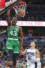 Boston Celtics guard Javonte Green (43) dunks over Orlando Magic forward Aaron Gordon during the second half of an NBA basketball game, Friday, Jan. 24, 2020, in Orlando, Fla. (AP Photo/John Raoux)