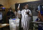 Burkina Faso opposition candidate Zephirin Diabre casts his ballot in the presidential and legislative elections in Ouagadougou, Sunday Nov. 22, 2020. (AP Photo/Sophie Garcia)