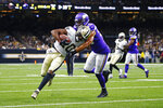 New Orleans Saints wide receiver Tre'Quan Smith (10) carries against Minnesota Vikings outside linebacker Anthony Barr in the first half of an NFL preseason football game in New Orleans, Friday, Aug. 9, 2019. (AP Photo/Butch Dill)