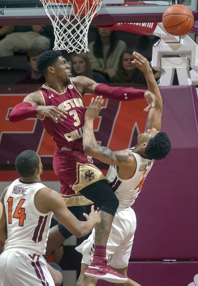 Boston College guard Jared Hamilton (3) blocks a shot by Virginia Tech guard Nickeil Alexander-Walker (4) during the first half of an NCAA college basketball game Saturday, Jan. 5, 2019, in Blacksburg, Va. Va. Tech won 77-66. (AP Photo/Don Petersen)