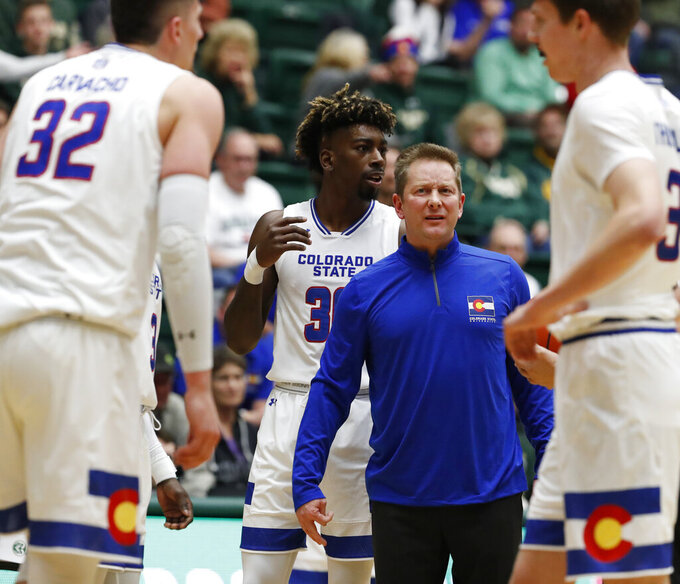 Colorado State head coach Niko Medved looks at center Nico Carvacho after he was slightly injured while battling for a rebound against Nevada during the first half of an NCAA college basketball game Wednesday, Feb. 6, 2019, in Fort Collins, Colo. (AP Photo/David Zalubowski)