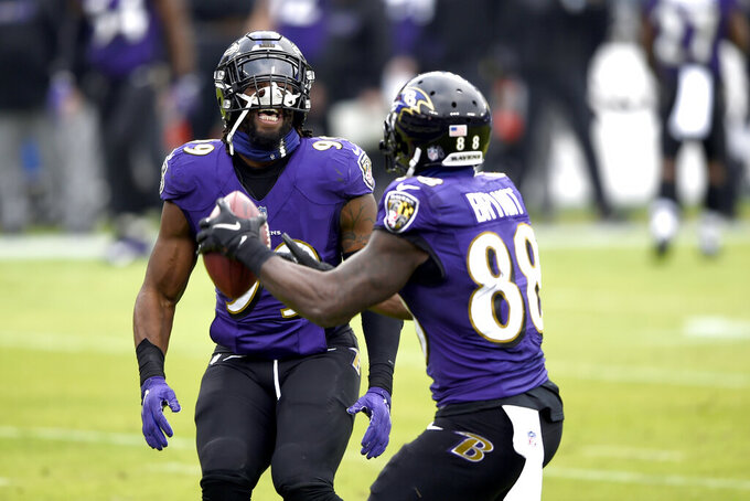 Baltimore Ravens wide receiver Dez Bryant (88) celebrates his touchdown catch against the Jacksonville Jaguars with linebacker Matthew Judon (99) during the first half of an NFL football game, Sunday, Dec. 20, 2020, in Baltimore. (AP Photo/Gail Burton)