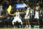 Providence's Luwane Pipkins (12) Greg Gantt (1) and Nate Watson, right, celebrate a three-pointer by A.J. Reeves, not pictured, during the second half of an NCAA college basketball game against Creighton Wednesday, Feb. 5, 2020, in Providence, R.I. (AP Photo/Stew Milne)