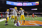 LSU wide receiver Ja'Marr Chase (1) celebrates after scoring with wide receiver Justin Jefferson during the first half of a NCAA College Football Playoff national championship game against Clemson Monday, Jan. 13, 2020, in New Orleans. (AP Photo/Gerald Herbert)