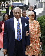Bill Cosby, left, arrives with his wife, Camille, for his sexual assault trial, Tuesday, April 24, 2018, at the Montgomery County Courthouse in Norristown, Pa. (AP Photo/Matt Slocum)