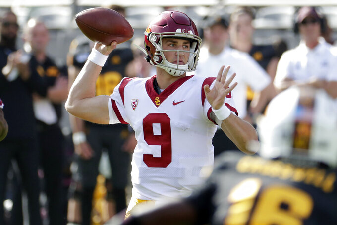 Southern California quarterback Kedon Slovis (9) throws against Arizona State during the first half of an NCAA college football game, Saturday, Nov. 9, 2019, in Tempe, Ariz. (AP Photo/Matt York)