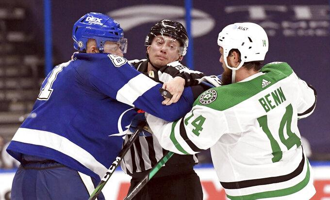 Tampa Bay Lightning defenseman Erik Cernak (81) and Dallas Stars left wing Jamie Benn (14) are separated during the third period of an NHL hockey game Friday, May 7, 2021, in Tampa, Fla. (AP Photo/Jason Behnken)