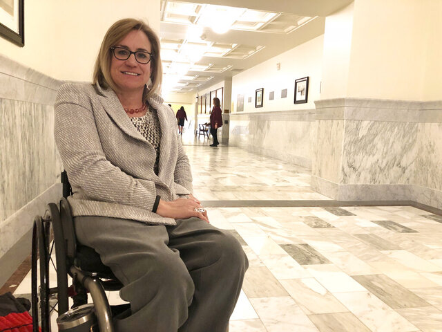 Democratic state Rep. Muffy poses in the hallway of the Idaho Statehouse in Boise, Idaho, Wednesday, Feb. 26, 2020. Idaho moved closer Wednesday to banning transgender women from competing in women's sports despite warnings that such a law is unconstitutional and uncertainties about how the NCAA might react. Davis, a seven-time medalist in Paralympic Games, said it could limit female participation because of the tests. (AP Photo/Keith Riddler)