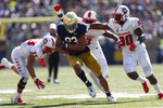Notre Dame wide receiver Chase Claypool (83) outruns New Mexico defenders after in pass reception the first half of an NCAA college football game in South Bend, Ind., Saturday, Sept. 14, 2019. (AP Photo/Paul Sancya)
