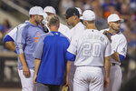 New York Mets relief pitcher Edwin Diaz, center, talks to manager Mickey Callaway, left, before leaving the baseball game during the ninth inning against the Atlanta Braves, Saturday, Aug. 24, 2019, in New York. (AP Photo/Mary Altaffer)