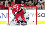 Carolina Hurricanes' Andrei Svechnikov (37) puts a goal past San Jose Sharks' Aaron Dell (30) during the shootout in an NHL hockey game in Raleigh, N.C., Thursday, Dec. 5, 2019. (AP Photo/Chris Seward)
