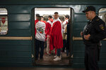 Soccer fans ride in the metro near the Luzhniki stadium before the group A match between Russia and Saudi Arabia which opens the 2018 soccer World Cup in Moscow, Russia, Thursday, June 14, 2018. (AP Photo/Felipe Dana)